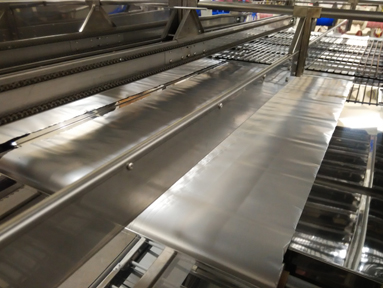 EdgeGrabber Conveyor for TrioTek Conformal Coating Curing Oven